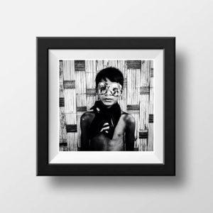 ©Jason Florio - portrait of a young Gambian boy wearing a mardi gras mask bw