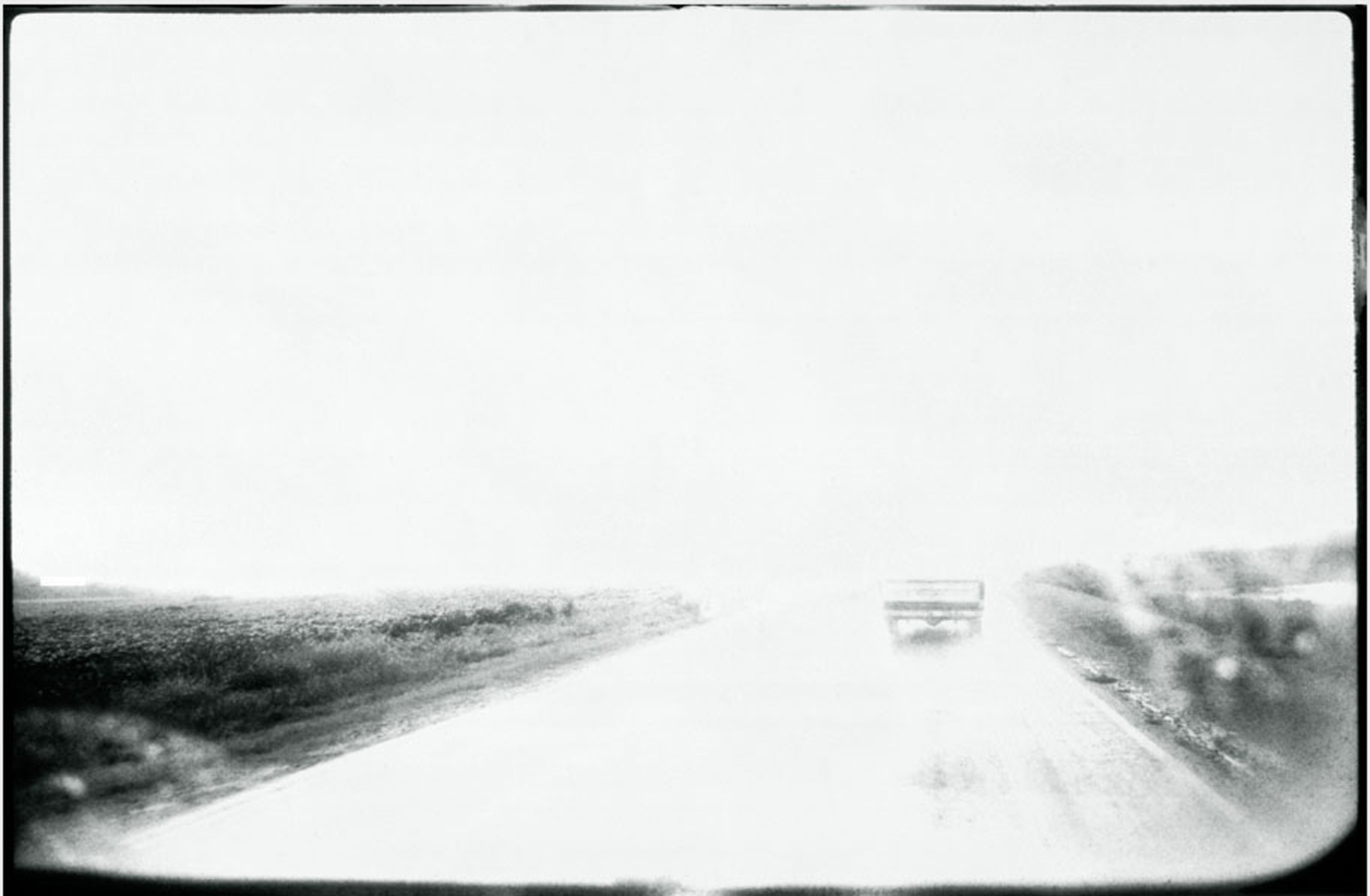 ROAD TRIP TRUCK © Chris Bartlett. Black and white framed print - the road ahead, viewed through windscreen