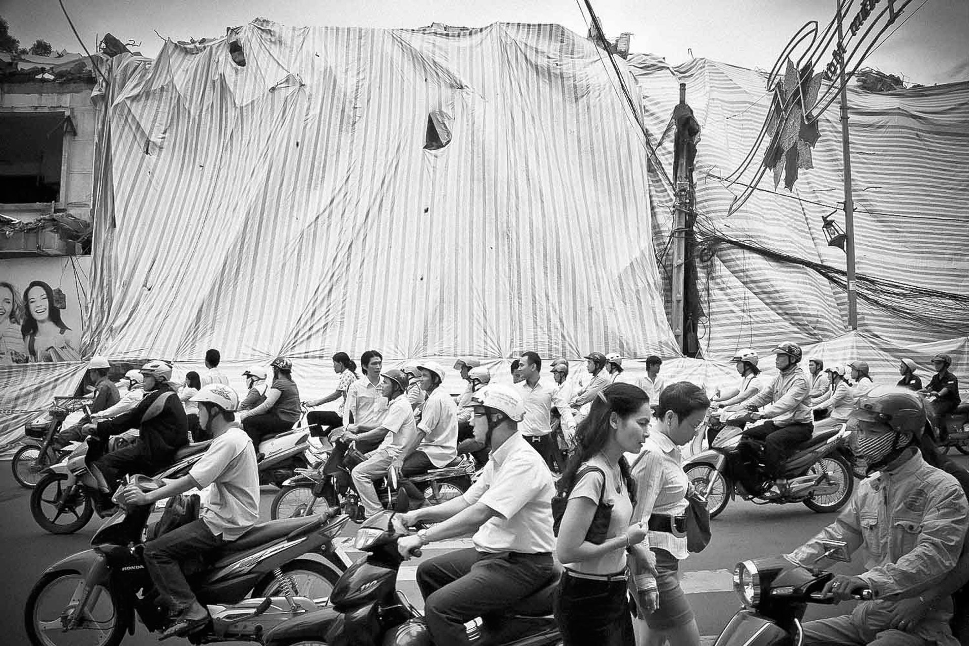 ©Ken Shung 'Crossroads, China'. Black and white - busy street full of motorcyclists, China