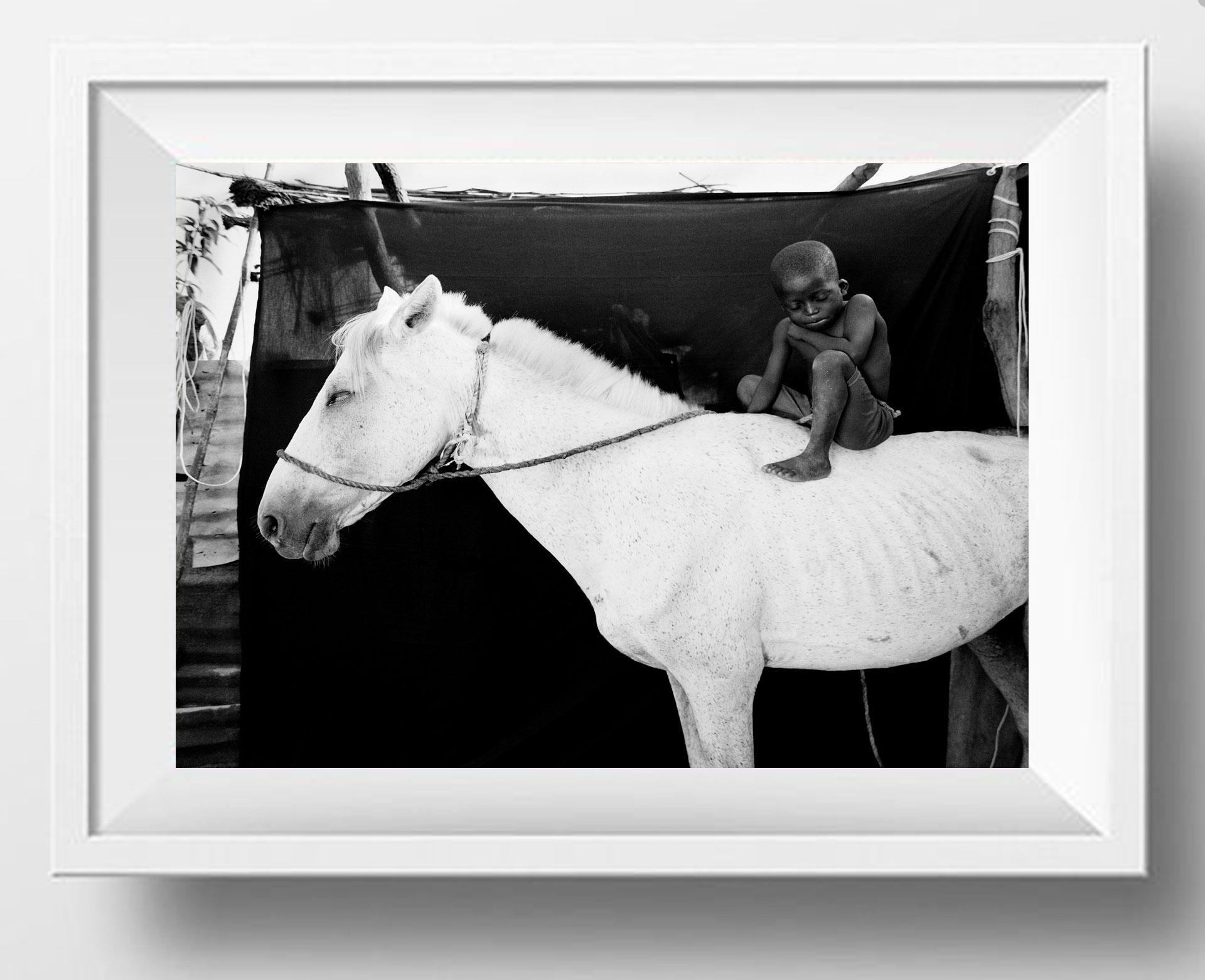 ©JASON FLORIO - 'ISMAILA ON HIS WHITE HORSE, JUMPEX'. Black & white framed photography prints -small boy on horseback