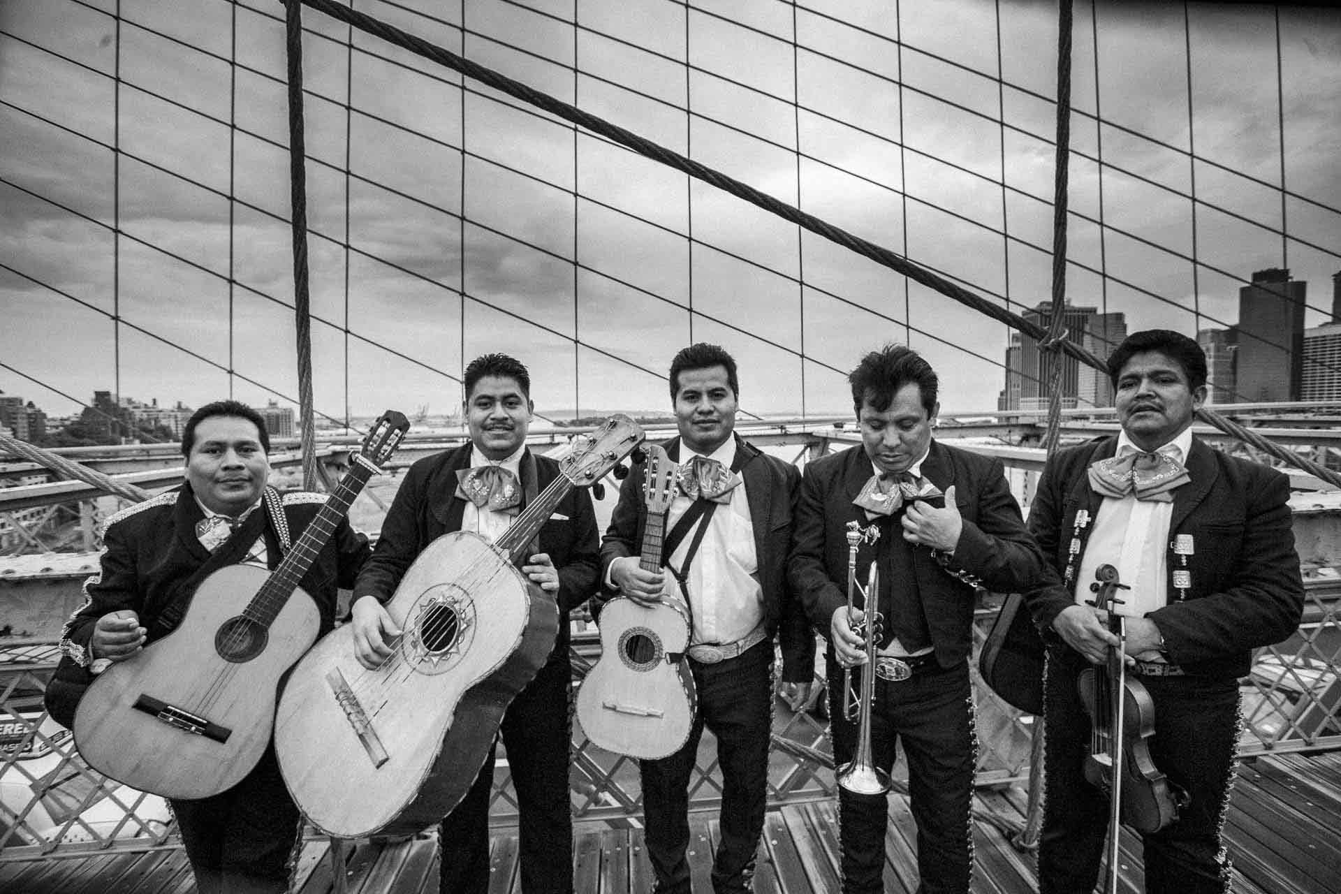 @Ken Shung - New York Rain, 2010 . Black and white - band standing on the bridge holding instruments
