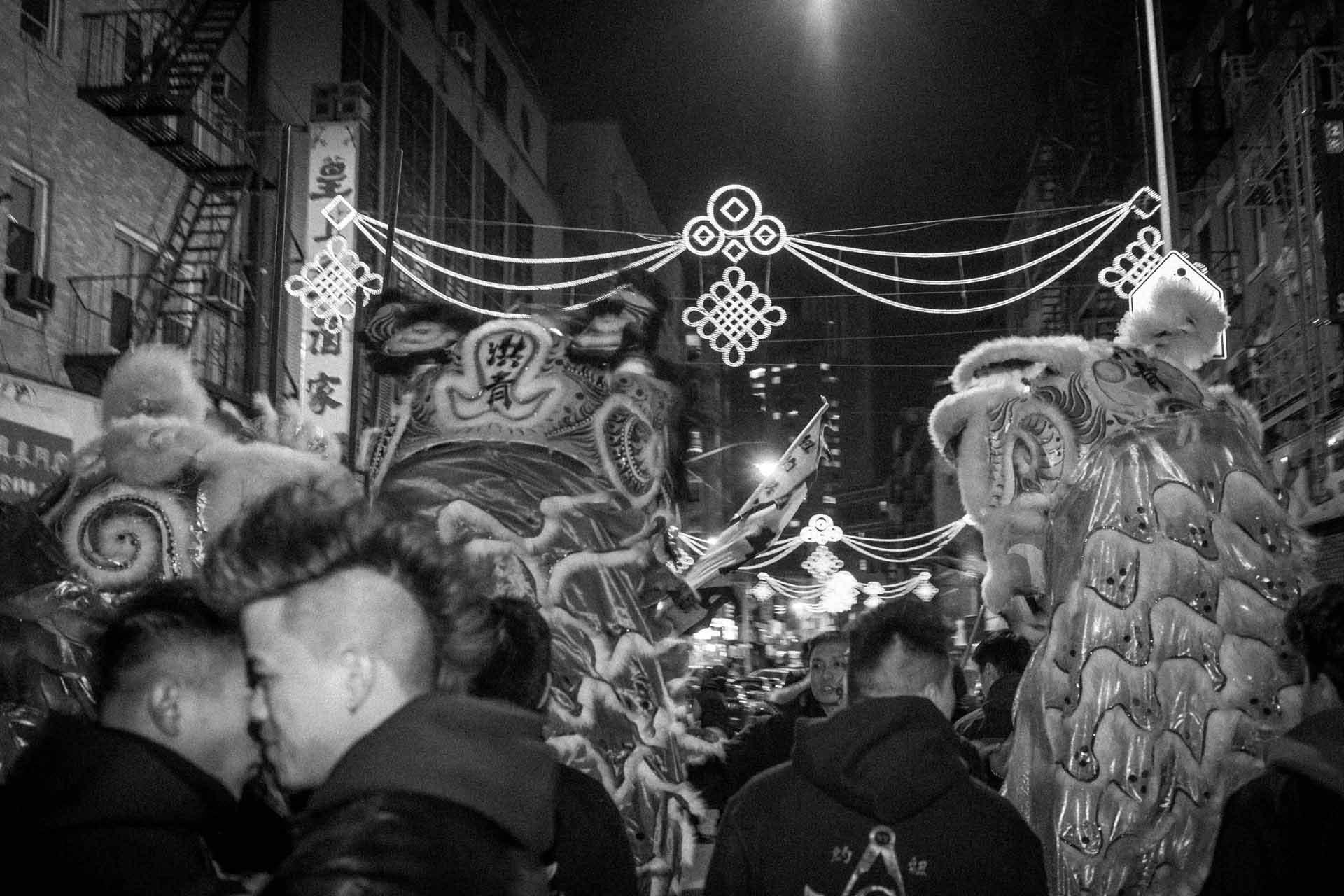 ©Ken Shung - Year of the Horse. black and white-young Chinese men celebrating Chinese New Year, China Town, NYC