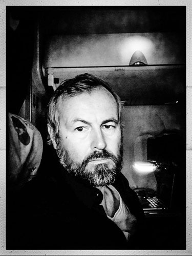 Black and white Portrait of photographer Jason Florio