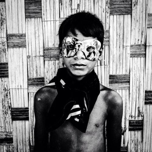 BW portrait of 'Boy in Mask' Burma © Jason Florio