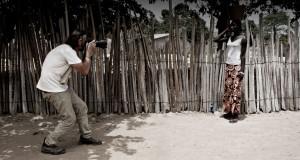 Image of Photographer Jason Florio - photographying a young Gambian girl, The Gambia, West Africa © Helen Jones-Florio