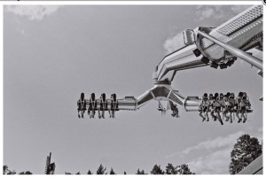 Ken Shung Photography - black and white image of people on a fairground ride, NYC