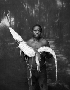 ©Jason Florio -'Abdou with Rescued Crocodile' The Gambia, West Africa. From the award-winning 'Makasutu' series of portraits