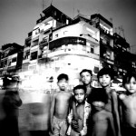 ©Jason Florio - Street Life, Cambodia . Black & White - group of children, on a busy night time street