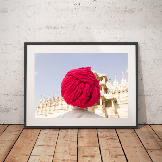 ''Fuchsia Turban' India © Jason Florio-color Sheikh stands facing a temple in bright pink turban