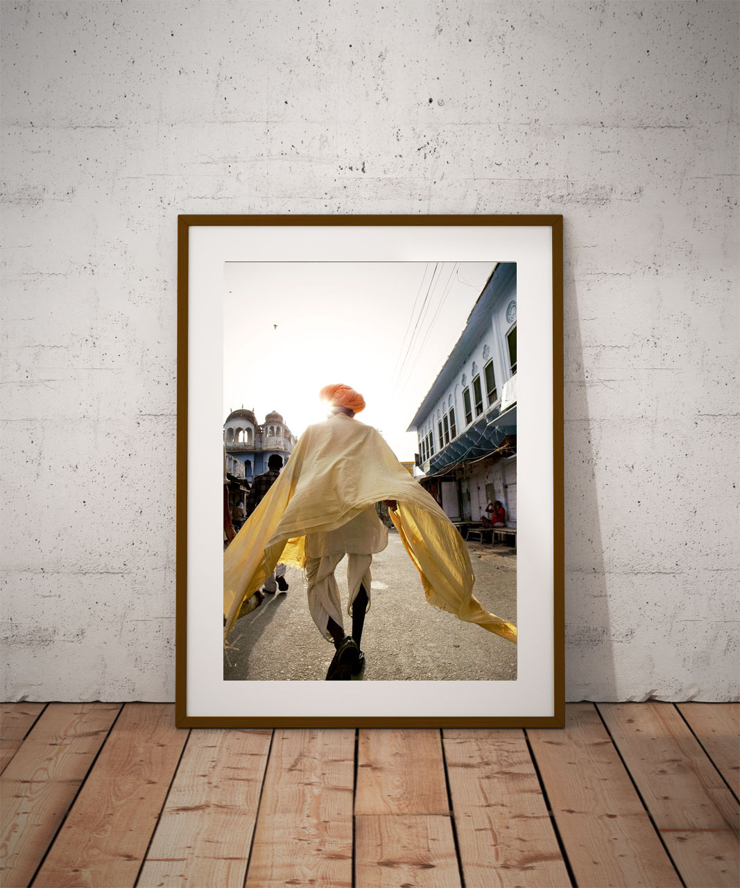 'Pushkar Man Walking' © Jason Florio - color - Indian man walks down an urban street, saffron robes flowing