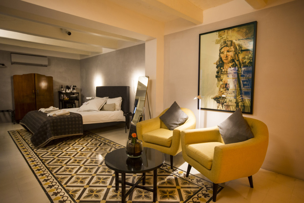 Ritty Tacsum Phorography - image of 'Devotion', in a large frame, mounted on the wall of one of the guest rooms Casa Ellul boutique hotel, Valletta, Malta
