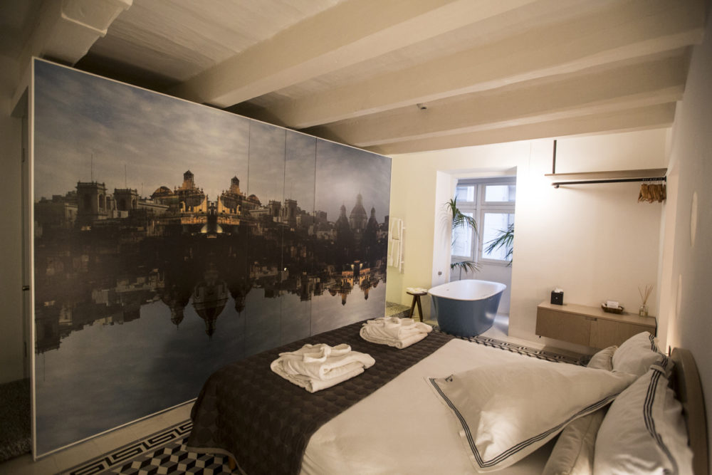 ©Ritty Tacsum 'Another Landscape', large mural format, on the wall of a guest rooms, Casa Ellul hotel, Valletta