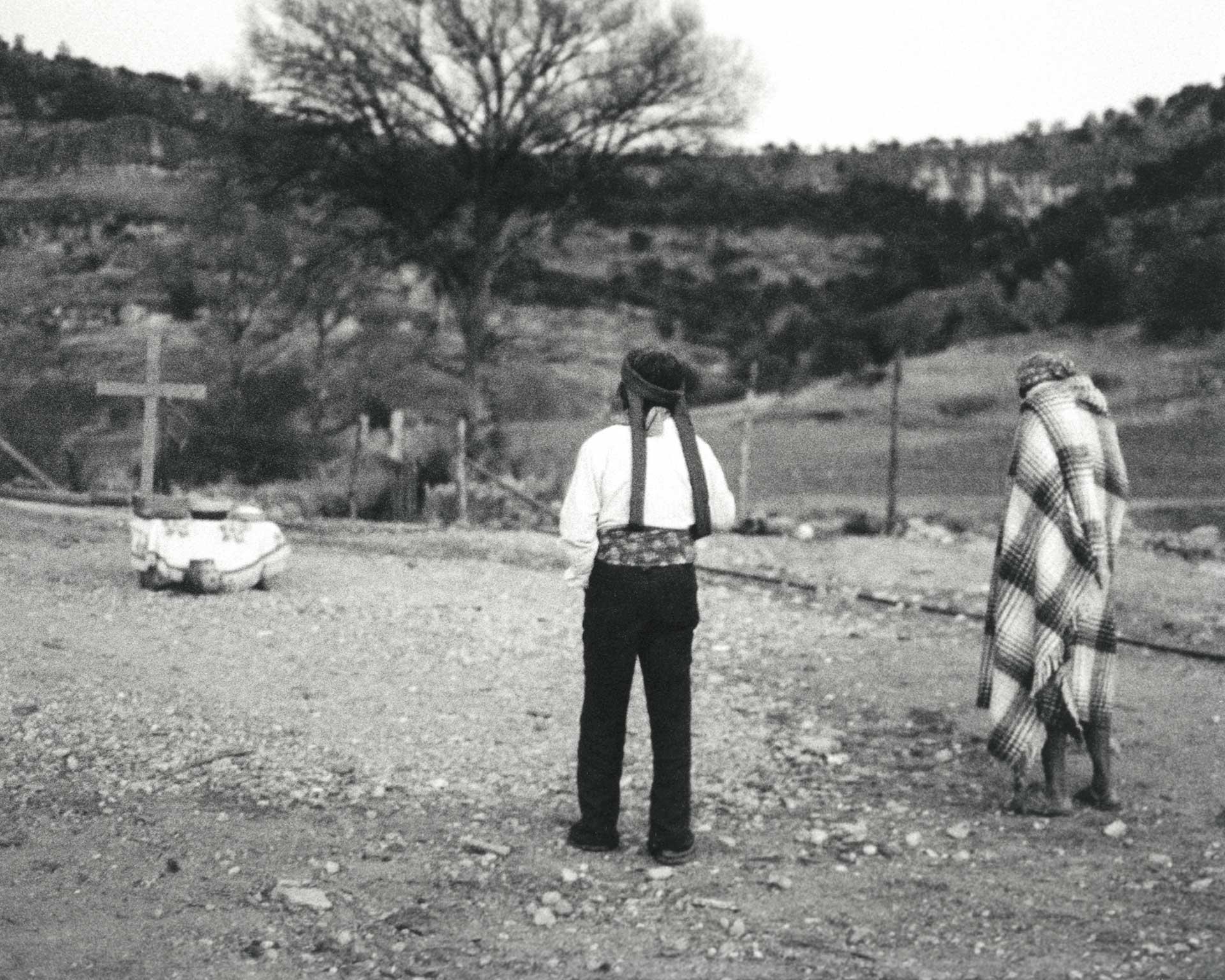 KWIRA (Tarahumara) #150 ©Oskar Landi . Black & white - two men walking in cemetary