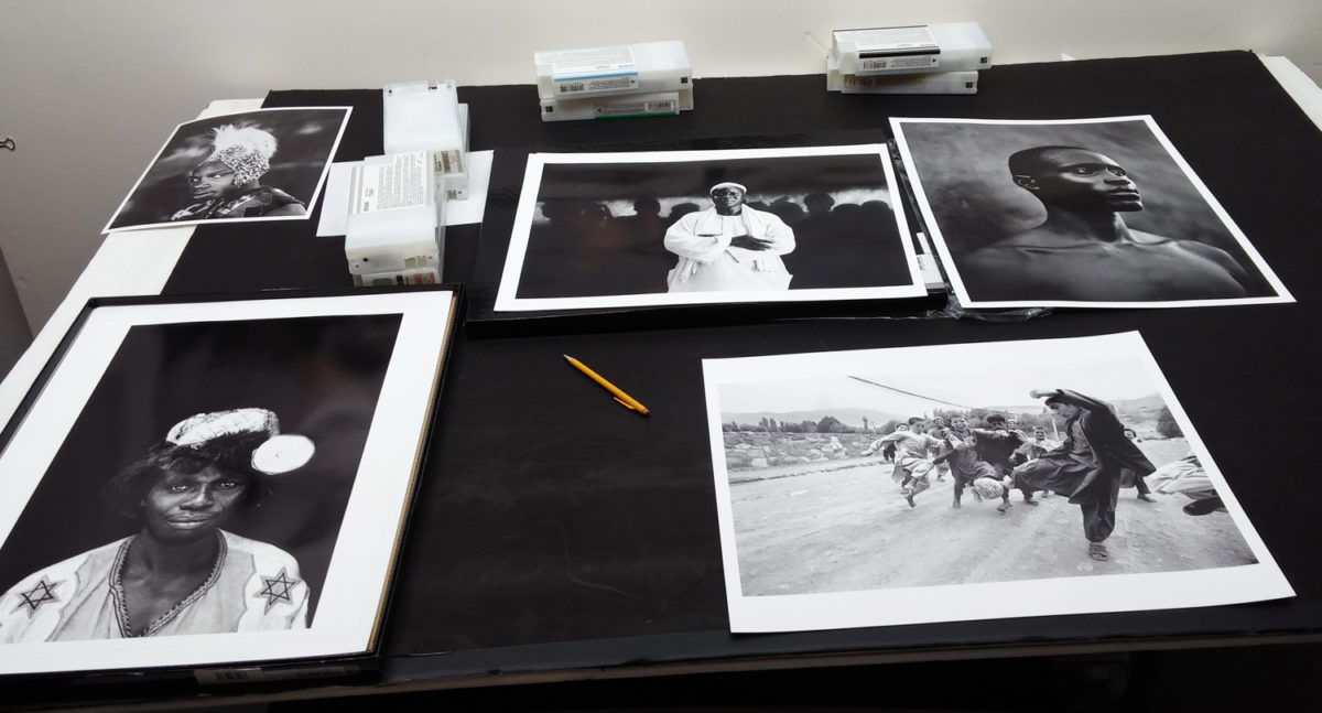 Jason Florio' photography - image of various black and white prints, from West Africa and Afghanistan, on a table in Pascal Prince's printing studio, NYC