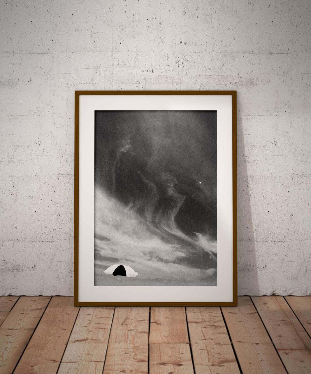 ©Chris Bartlett 'Jones Beach' USA- black and white - parasol against a moody sky. Framed