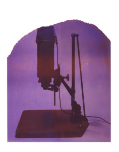 Polaroid image of a photographic print enlarger