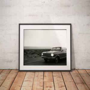 'Palm Springs' Route 66, USA ©Chris Bartlett. Black and white framed print -vintage convertible car, driving through the desert