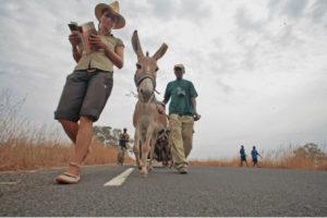 Helen Jones-Florio walks with the donkey on A Short Walk in the Gambian Bush © Jason Florio