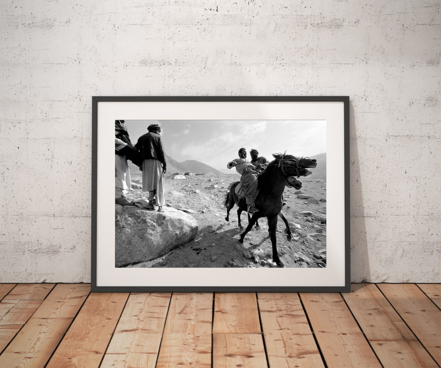 'AFGHAN NOMADS & HORSES' © JASON FLORIO BW men on horses playing Buzkashi in desert
