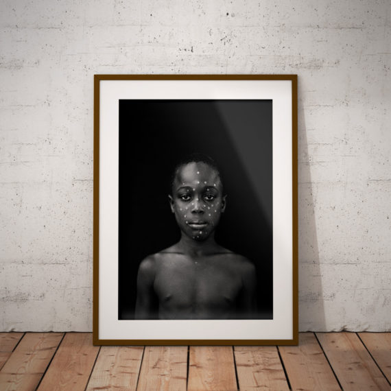 Black and white portrait of young black boy with sequins on his face, Gambia, W Africa 'BOY WITH SEQUIN FACE (COMING OF AGE CEREMONY)' ©JASON FLORIO