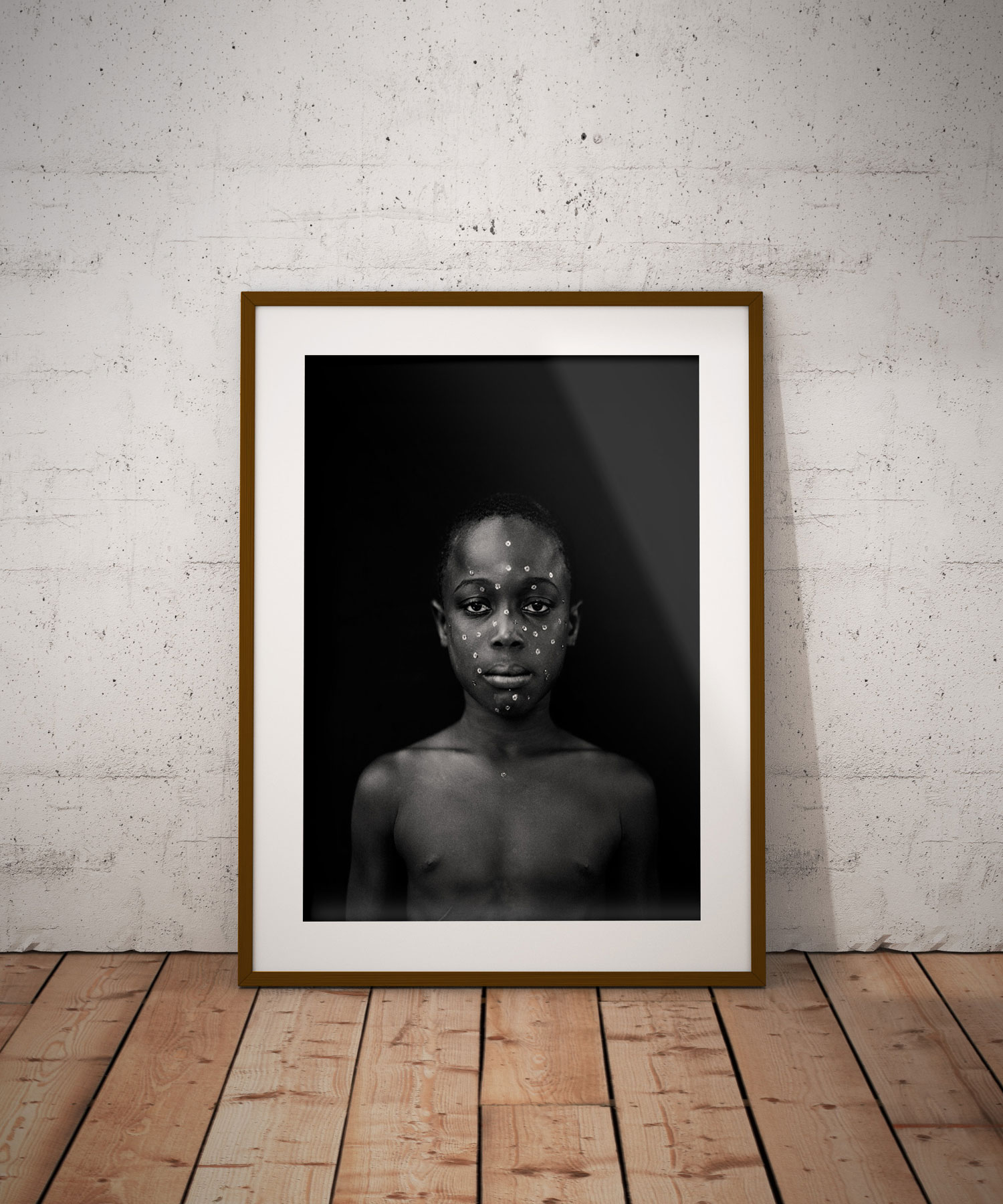 The black backdrop - Black and white portrait of young black boy with sequins on his face, Gambia, W Africa 'BOY WITH SEQUIN FACE (COMING OF AGE CEREMONY)' ©JASON FLORIO
