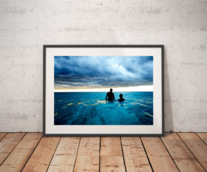 'CUBA SEA CLOUDS' © JASON FLORIO-color two men wading in the blue sea, Havana