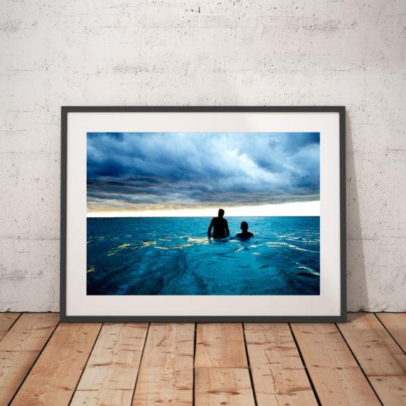 'CUBA SEA CLOUDS' © JASON FLORIO-color two men wading in the blue sea, Havana