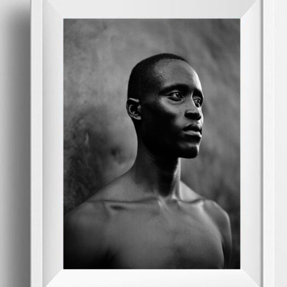 Black and white print of a strong, proud, Gambian man, The Gambia, W Africa 'ENSA MECHANIC' © Jason Florio