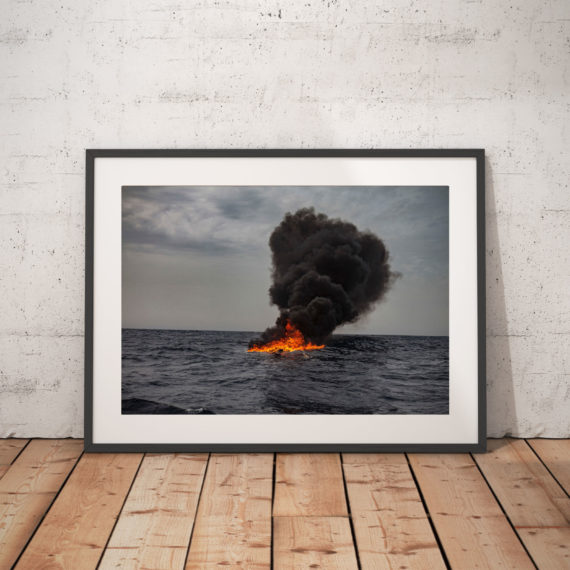 'FIRE WATER' © JASON FLORIO small smugglers boat on fire in the Mediterranean sea