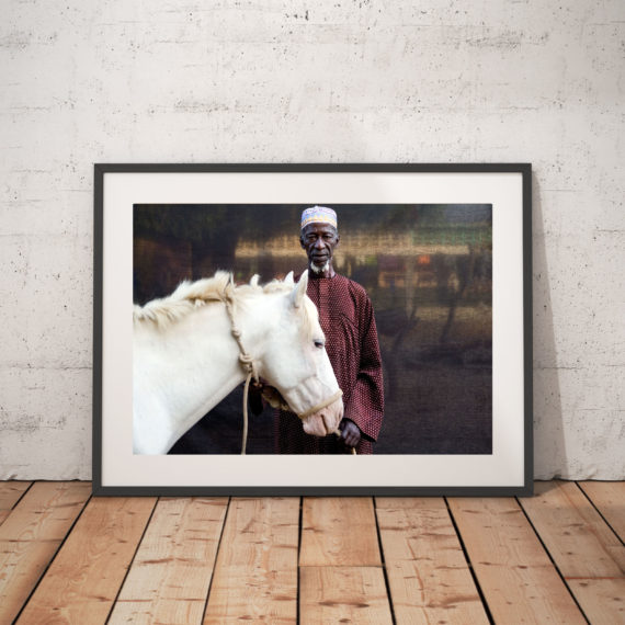 'HEROUNA WITH HIS WHITE HORSE' © JASON FLORIO colour - VILLAGE CHIEF (ALKALO), THE GAMBIA, WEST AFRICA