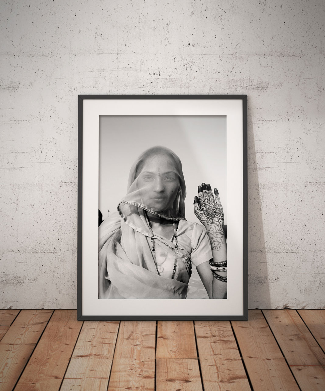 'INDIAN BRIDE WITH HENNAED HAND' © jason florio BW portrait of woman holding up her decorated hand