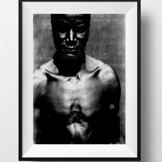 Black and white portrait of a strong Gambian man, The Gambia, W Africa - OYSTER COLLECTOR © Jason Florio