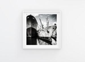 RELICS © Helen Jones-Florio. Black and white-rusty ships in shipyard, Malta