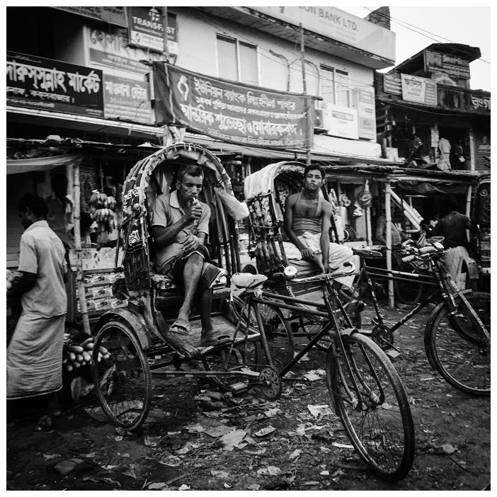 Square Prints Photography Prints 'Tuk Tuks' Bangladesh © Jason Florio. Two tuk tuk drivers parked in an urban street