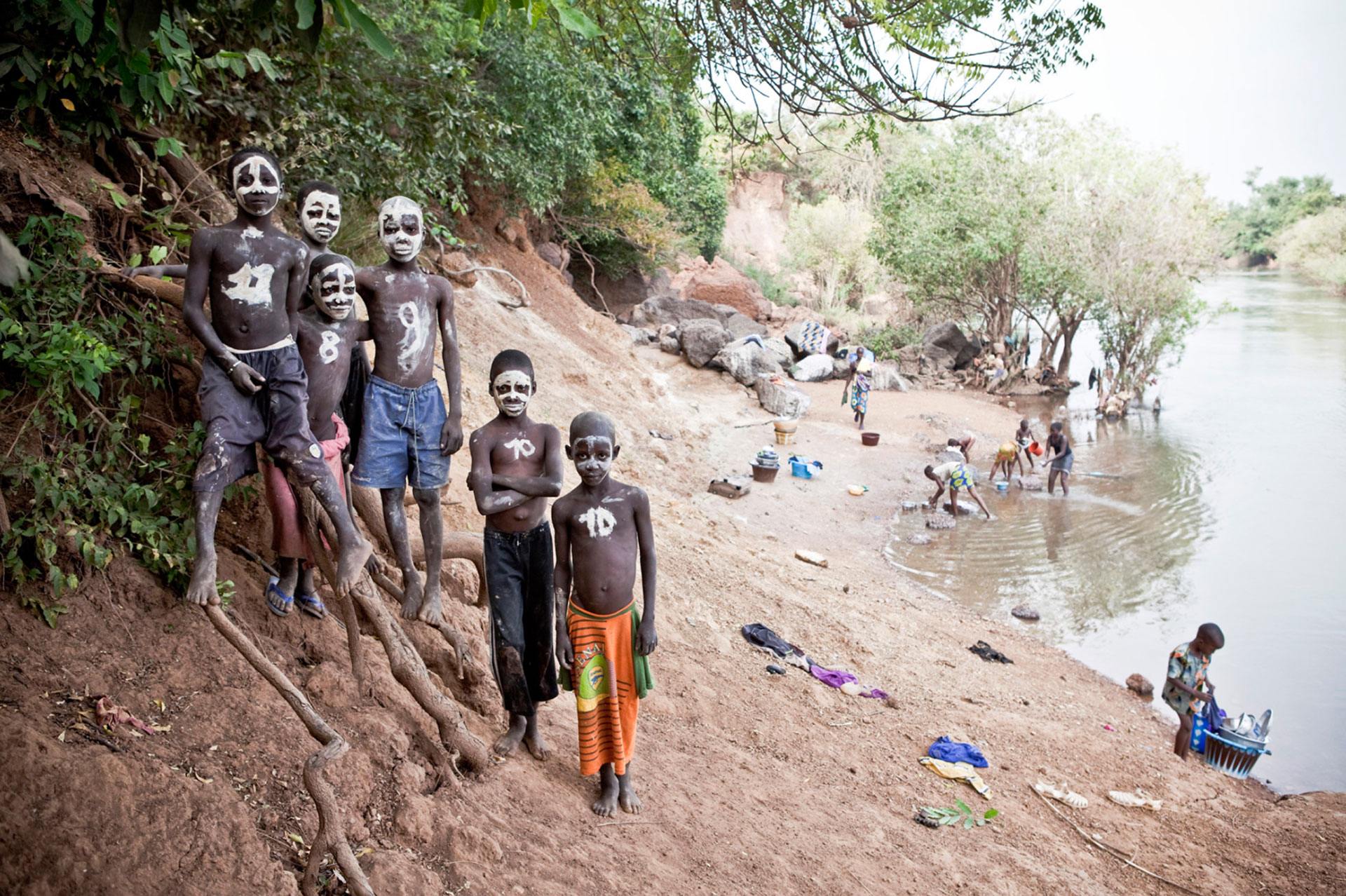 ©Jason Florio - Boys with painted faces on the banks of the River Gambia, Senegal