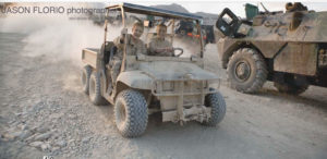 ©Jason Florio - two off-duty US soldiers driving a buggy on a FO base, Afghanistan
