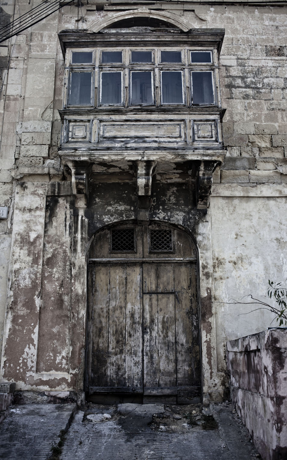 Wabi sabi Doors and facades, with traditional Maltese balcony, Msida, Malta ©Helen Jones-Florio