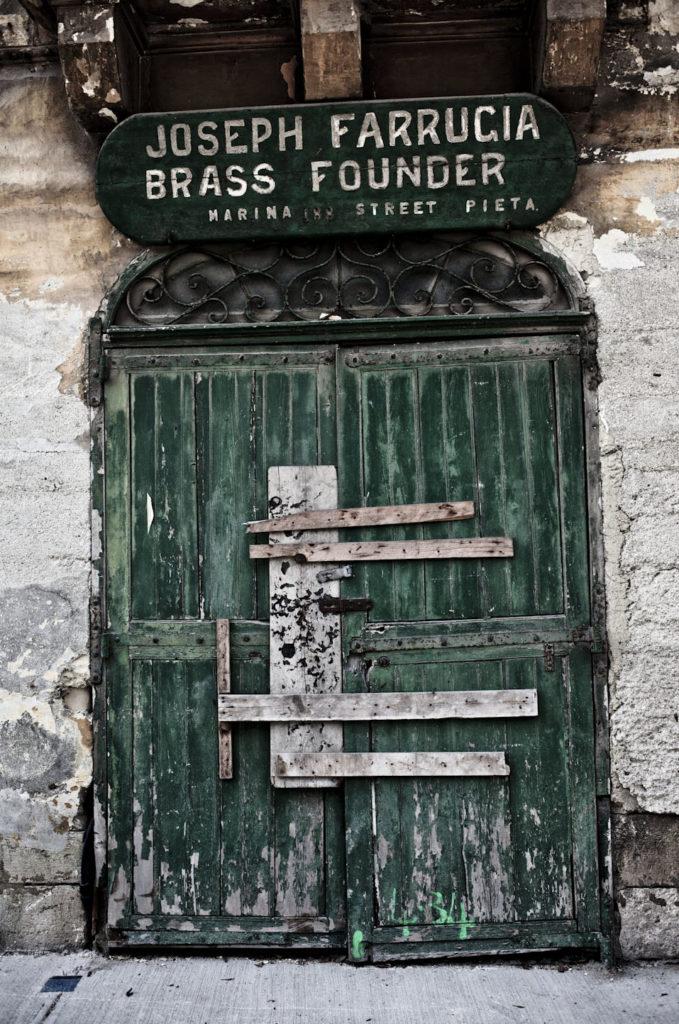 Wabi-sabi Doors and facades,Doors and facades - 'Joseph Farrugia Brass Founder',  Pieta, Malta ©Helen Jones-Florio