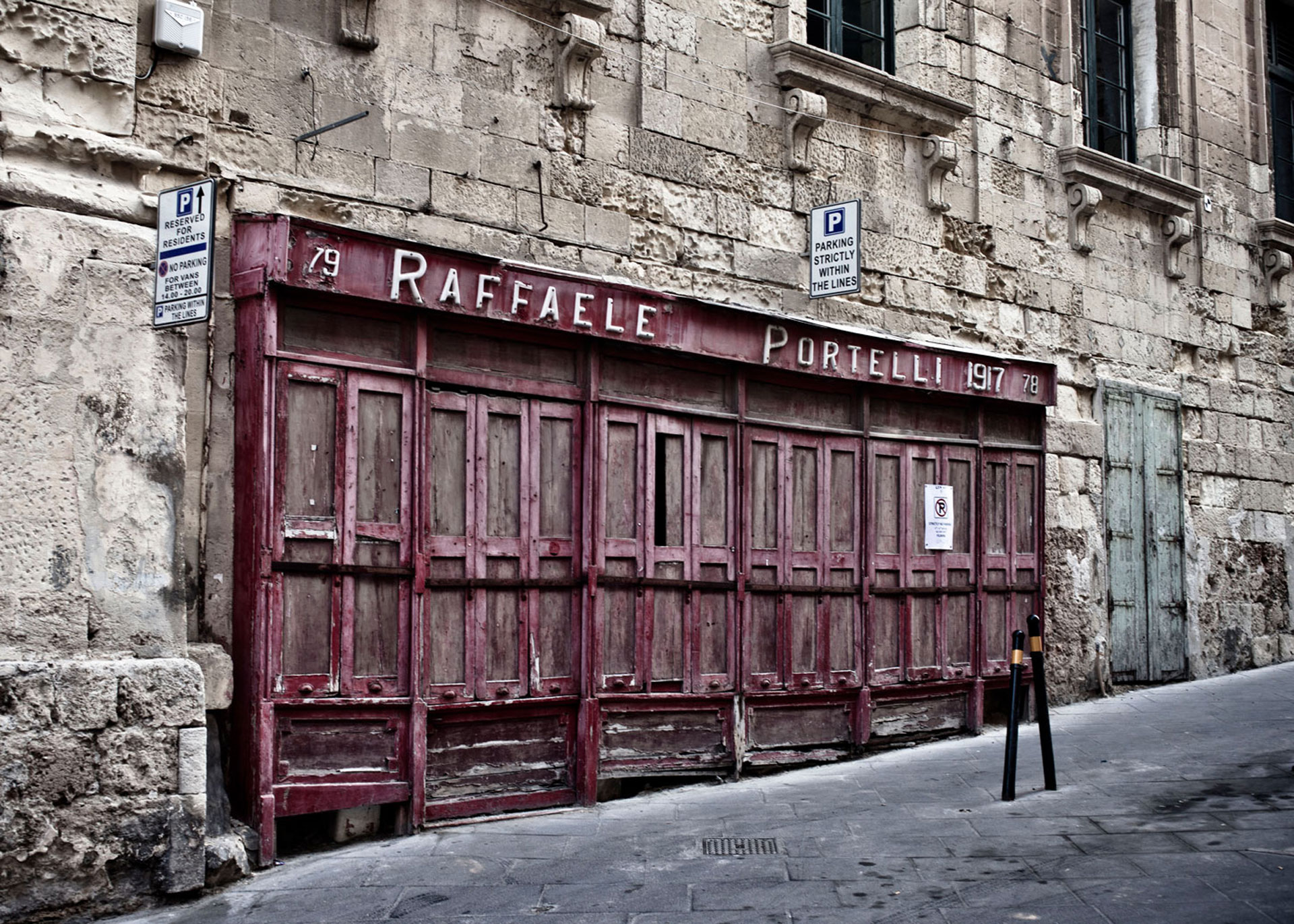 Disappearing Malta - doors and facades ©Helen Jones-Florio. 'Raffaele Portelli, 1917', Merchant St, Valletta