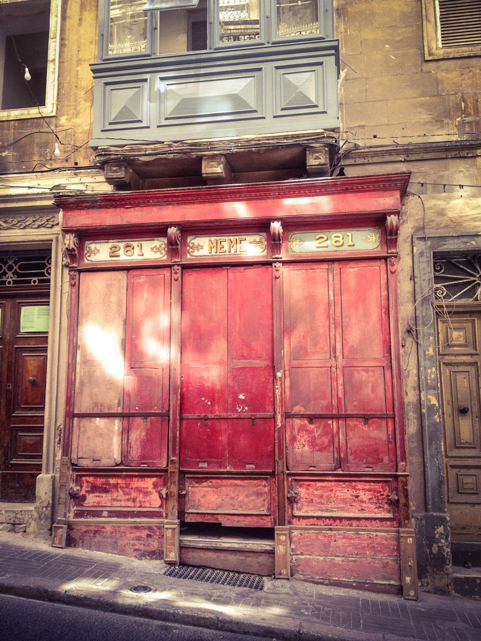 Disappearing Malta - doors, and facades ©Helen Jones-Florio. 'Meme' storefront, St Paul Street, Valletta