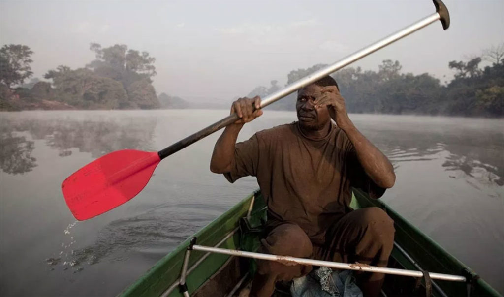 River Gambia Expedition team mate, Abdou Ndong, paddles at dawn in Southern Senegal ©Jason Florio / SAFARI254