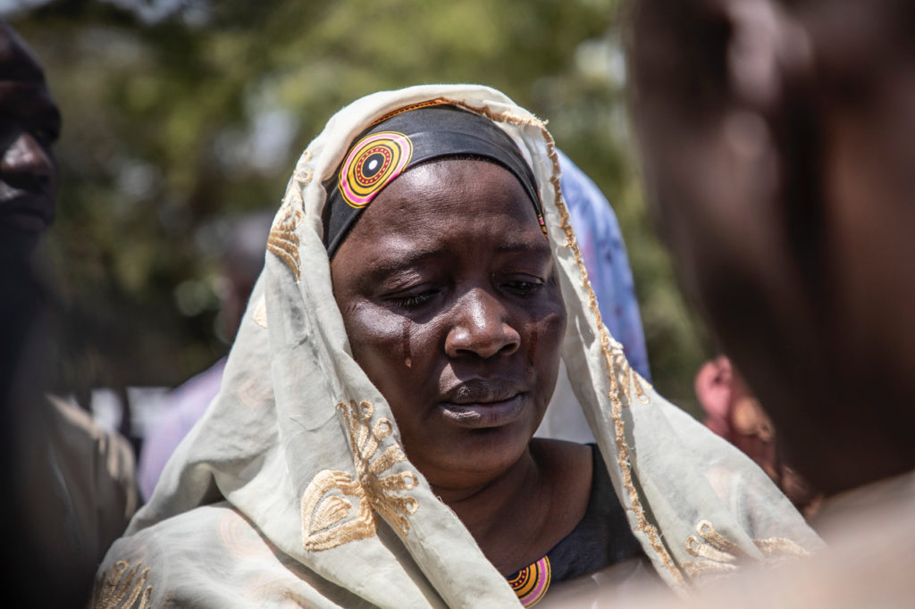 Image ©Jason Florio, families come to mourn the remains of their loved ones, exhumed at Yundum Barracks, Gambia, West Africa