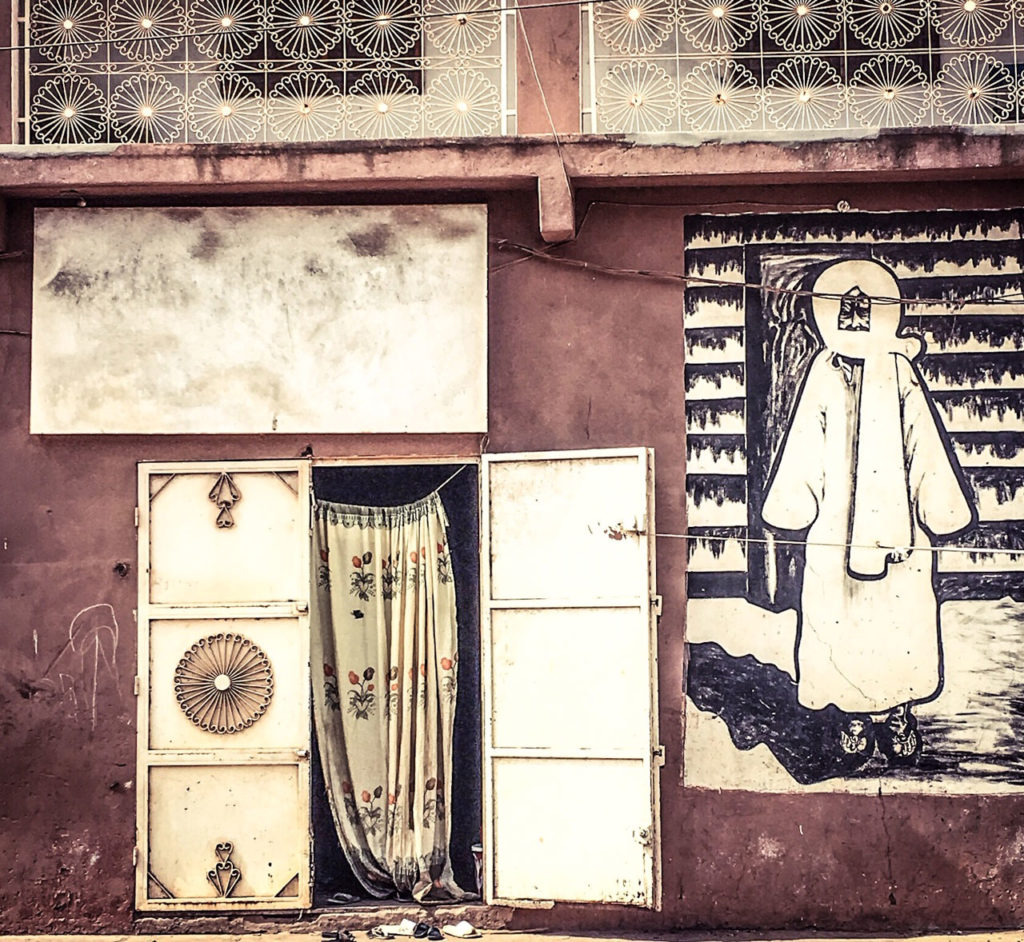 Doors - 'Serigne Touba' mural on the front of a house in the capital, Banjul, the Gambia ©Helen Jones-Florio