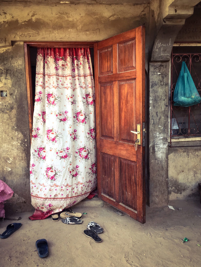 Doors - the doorway to the house of Mr Chune, who's son was shot dead during student protests, 2000,, The Gambia, West Africa ©Helen Jones-Florio