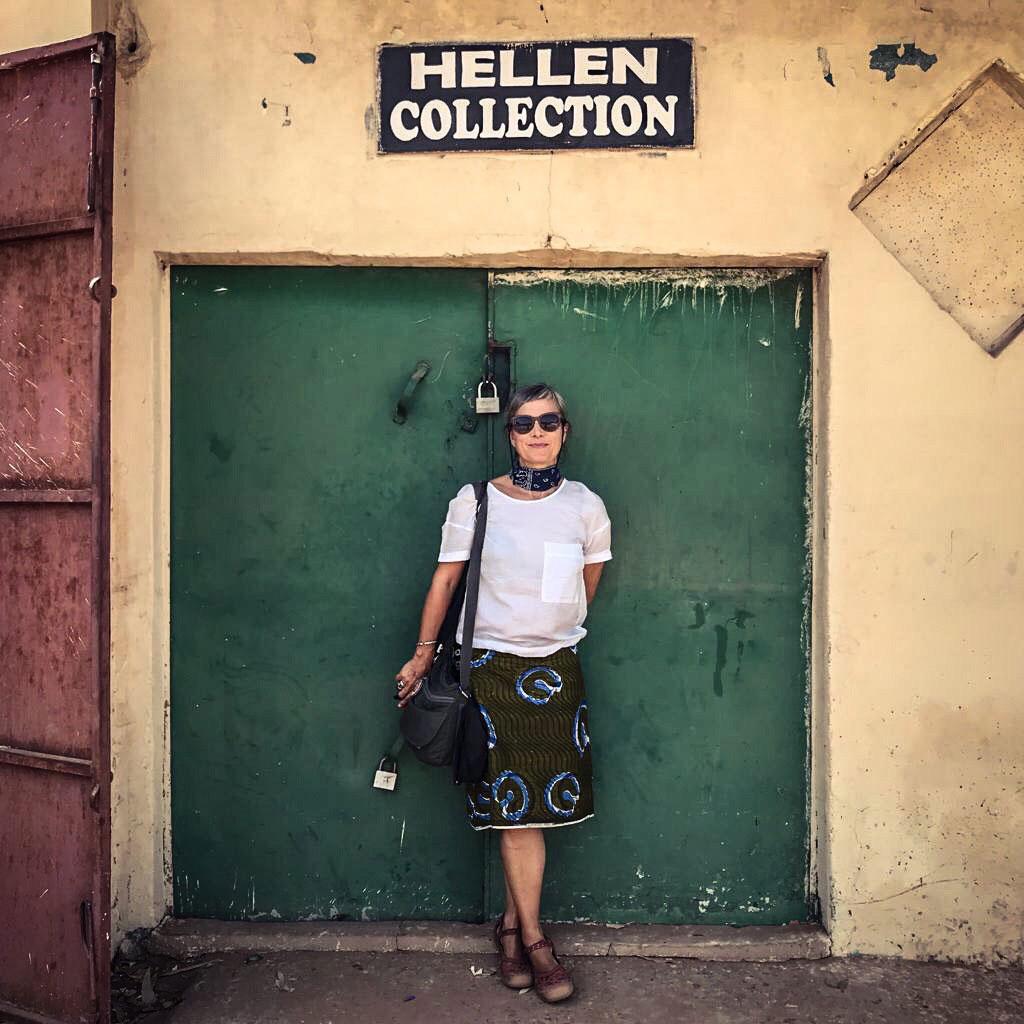 Doors - Helen Jones-Florio stands infront of a door called 'Hellen Collection', Bakau, The Gambia, West Africa ©Jason Florio