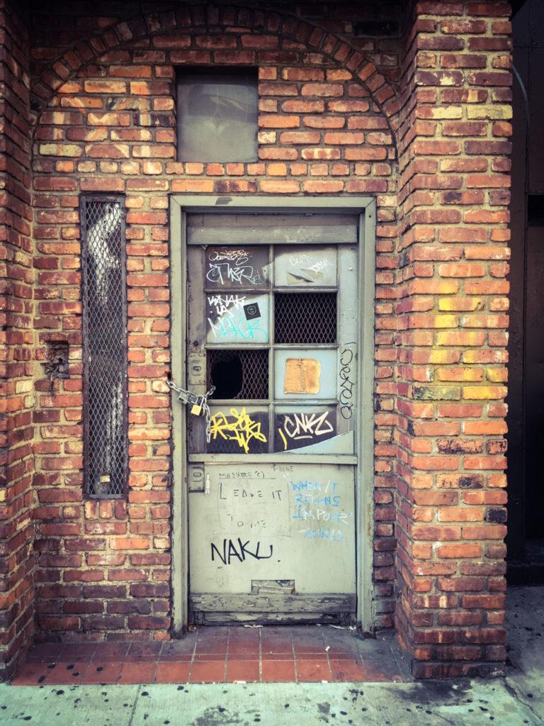 #DisappearingNewYork: derelict door with graffiti, 7th Ave, Manhattan, NYC © Helen Jones-Florio.