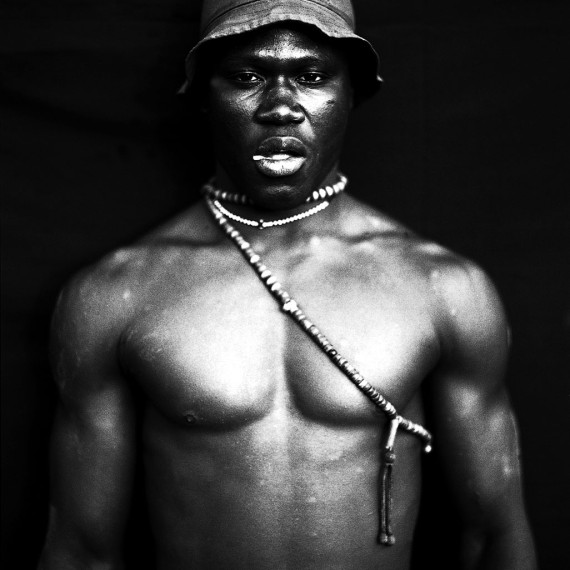 ©Jason Florio - 'The Wrestler', The Gambia, West Africa. BW portrait from Makasutu series, against black cloth background