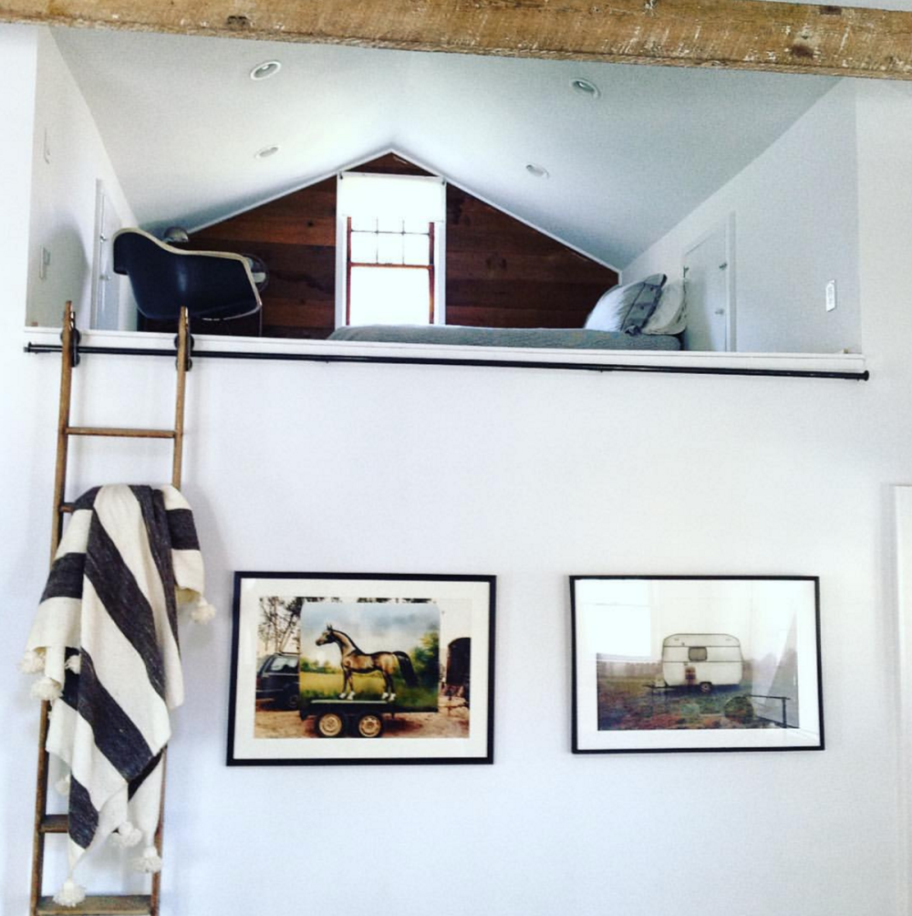 Print Orders - image of an interior designed wall with two framed prints, one of a horse box, the other an old Caravan, in a field