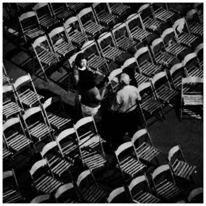 Black and white image chairs arranged for party gathering 'Festa Time, Gozo' © Jason Florio