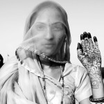 ©Jason Florio 'Indian bride with hennaed hand'. BW portrait of young woman in bridal sari